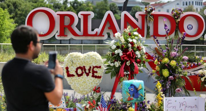 Visitors pay their respects on Tuesday to the victims of the Pulse shooting at a makeshift memorial atOrlando Regional
