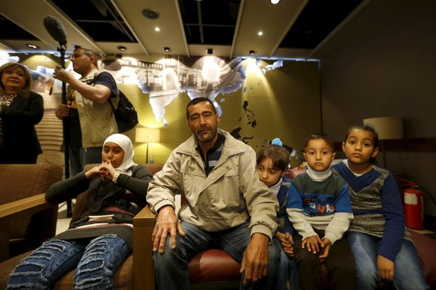 Syrian refugee Ahmad al Aboud, center, and his family members, who will be resettled in the U.S. as part...