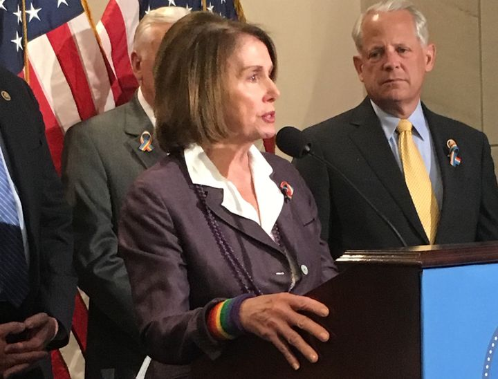 House Minority Leader Nancy Pelosi (D-Calif.) wears a rainbow wristband and ribbon while addressing the press about the Orlan