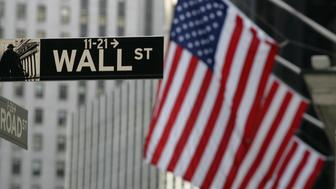 FILE - This Sept. 17, 2008 file photo shows a Wall Street sign in New York. U.S. stocks are opening lower Monday, July 6, 2015, after Greeks voted overwhelmingly to reject the terms of the country's latest bailout. (AP Photo/Mark Lennihan, File)