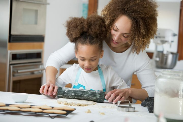 Black mother and daughter baking together Ariel Skelley via Getty Images