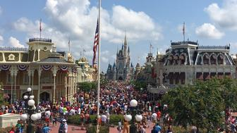 The flag is lowered to half-staff on Monday, June 13, 2016 in Walt Disney World's Magic Kingdom in honor of the victims who died in the Pulse nightclub shooting in Orlando. (Dewayne Bevil/Orlando Sentinel/TNS via Getty Images)