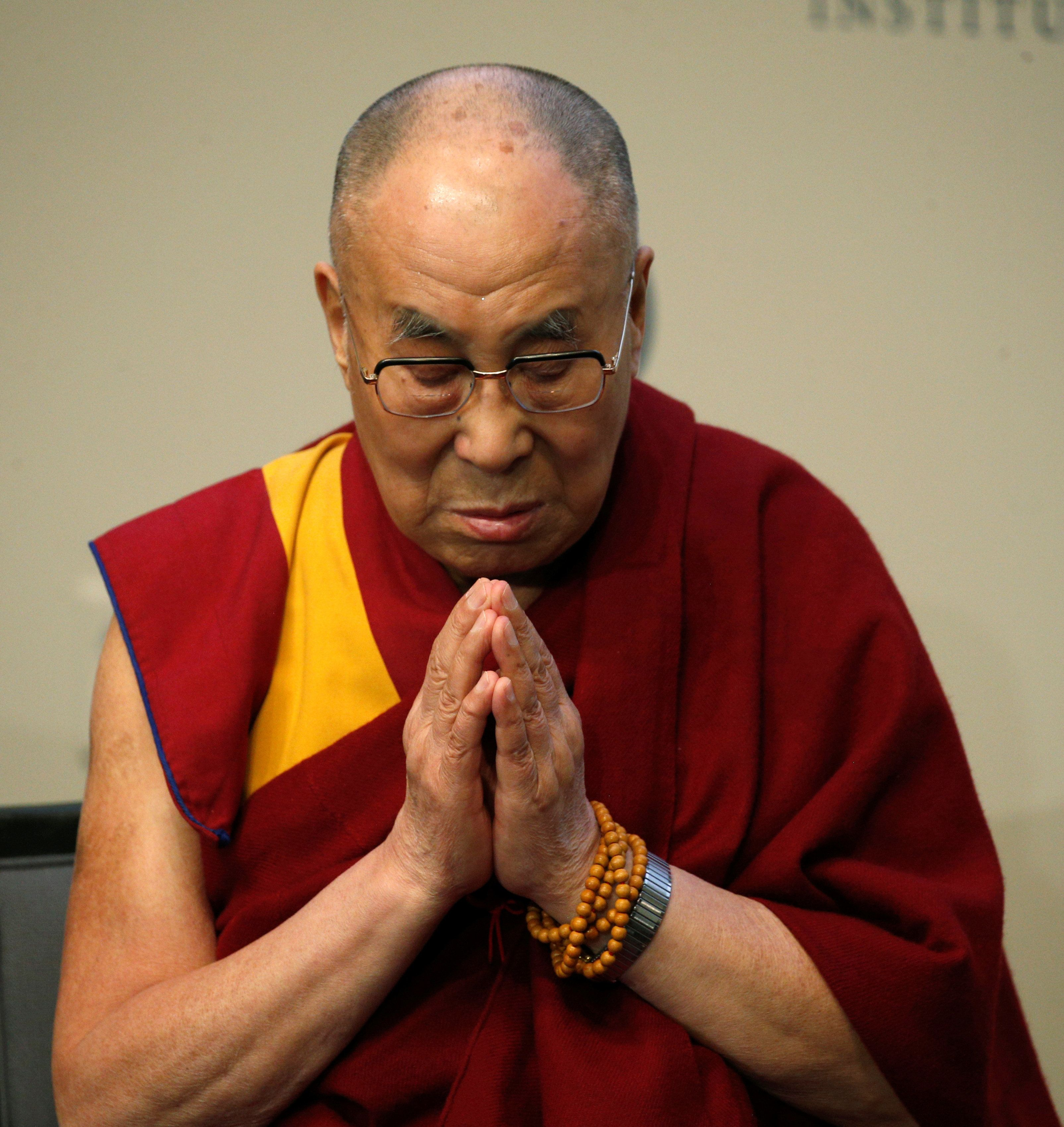 The Dalai Lama prays for the victims of the Orlando shooting before speaking at the U.S. Institute of Peace in Washington, D.