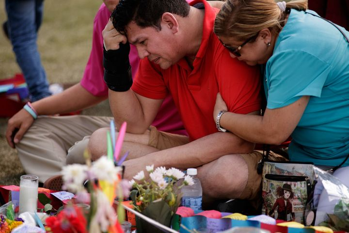 Cesar Rodriguez, friend of Amanda Alvear who was killed in the Orlando shooting, is comforted by Lisa Dominguez at a makeshif