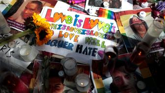 Images of victims and messages are seen at a makeshift memorial to remember the victims of the mass shooting at a gay nightclub in Orlando, outside the Stonewall Inn in Manhattan, New York, U.S., June 15, 2016. REUTERS/Mike Segar