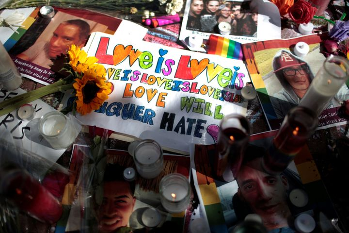 Images of victims and messages are seen at a makeshift memorial to remember the victims of the mass shooting at a gay nightcl