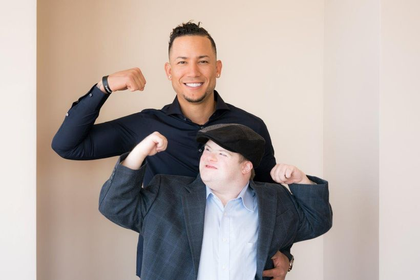 MLB Player Carlos Gonzalez and Author/Self-Advocate Marcus Sikora pose for Down Syndrome World Magazine