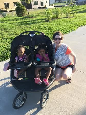 Kendra, 1; Olivia, 2; take candid photo with mom and baby sister Addison along a bike trail in West Des Moines, IA.