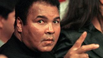 VERONA, :  File photo dated 08 October 1999, shows boxing great Muhammad Ali at the ringside before the match of his daugher Laila Ali and April Fowler at the Turning Stone Casino Resort in Verona, New York.  Ali said in an interview with Newsweek magazine that hit the newsstands 18 October 1999, that he planned to fight, a 15-round exhibition bout despite suffering from Parkinson's disease.   AFP PHOTO/FILES/Stan HONDA (Photo credit should read STAN HONDA/AFP/Getty Images)
