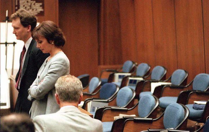 Prosecutors Hank Goldberg and Marcia Clark stand next to the empty jury box.