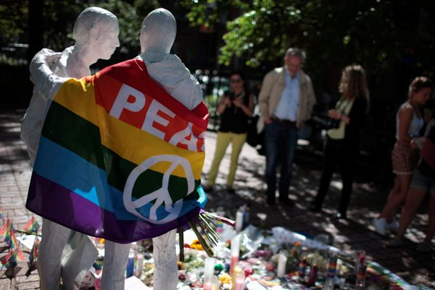 People visit a makeshift memorial to remember the victims of the mass shooting at a gay nightclub in...