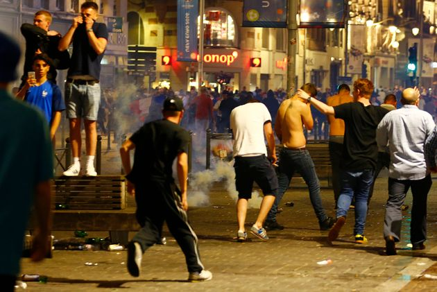 England fans run from tear gas in