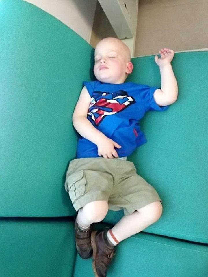 Dylan sleeping between blood draws in August 2014