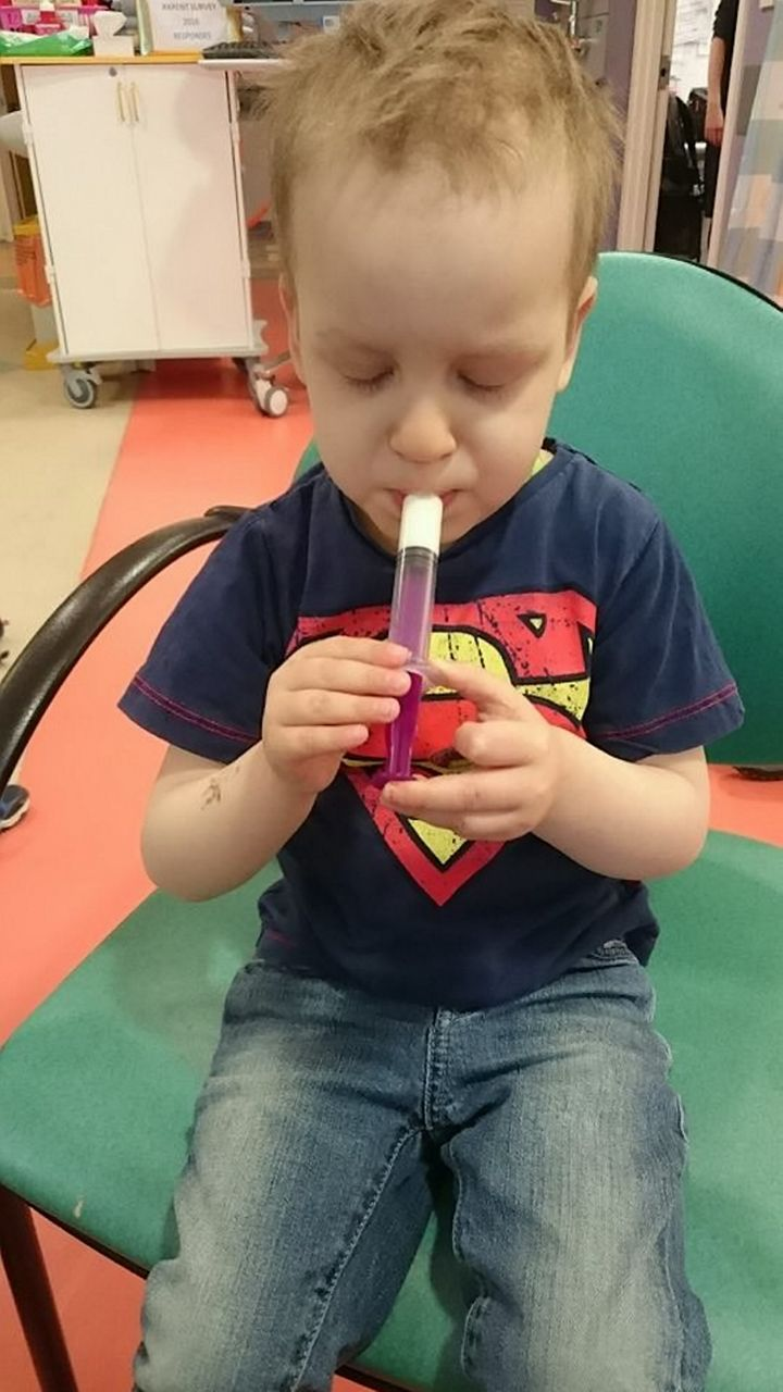Dylan taking his oral chemotherapy in April 2016