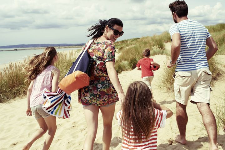 Family day out at the beach Brand New Images via Getty Images