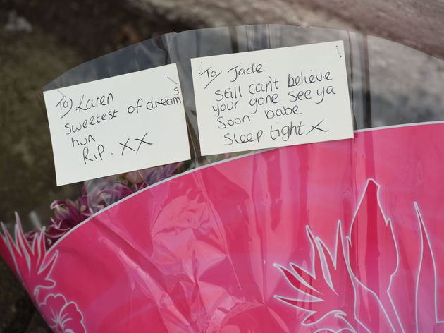 A floral tribute left on Cathedral Road, Liverpool, to Karen and Jade