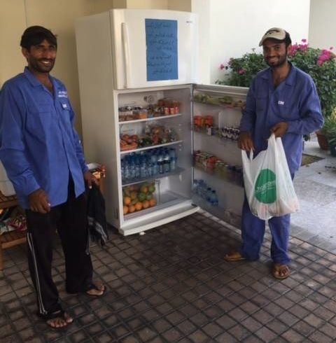 Local workers welcome the Sharing Fridge initiative, which allows them to grab food and beverages to break their fast during