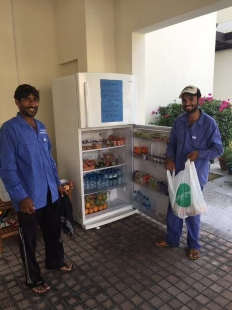 Local workers welcome the Sharing Fridge initiative, which allows them to grab food and beverages to break their fast during Ramadan.