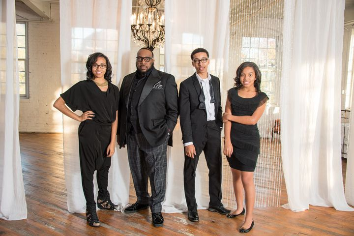 Marvin Sapp with his children, MiKaila, Marvin Jr., and Madisson.