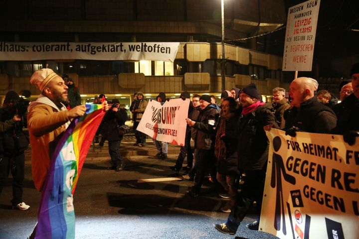 A group of people hold banners to protest racism and Islamophobia as the another demonstrator group, led by LEGIDA, Leipzig's