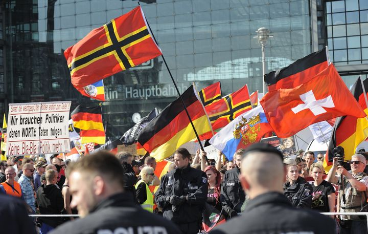 """Far right-wing demonstrators gather in front of Hauptbahnhof railway station under the banner """"We for Berlin - We for Germany"""