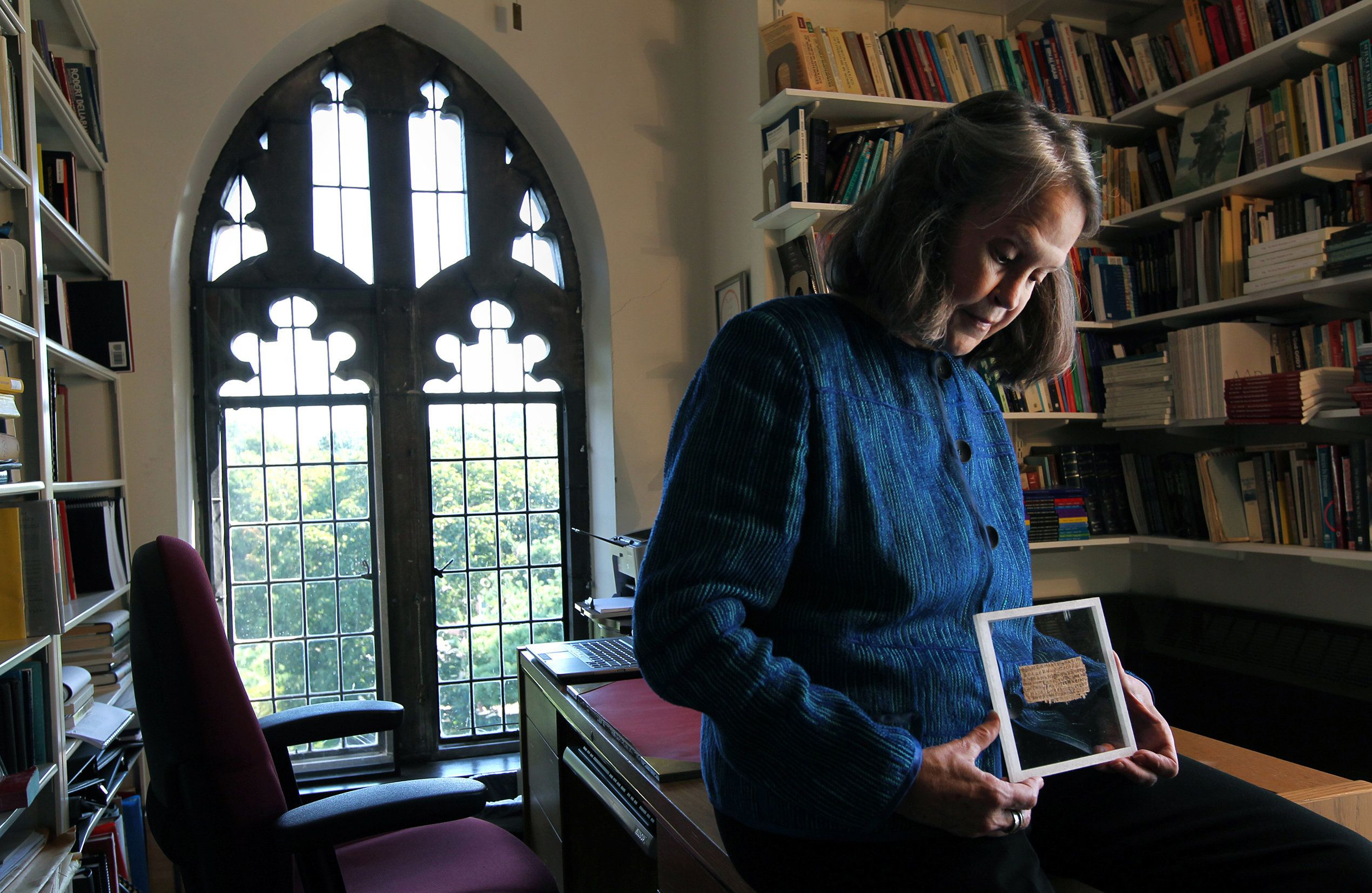 CAMBRIDGE, MA - SEPTEMBER 13: Karen L. King Hollis, Professor of Divinity at Harvard University, in her office with a papyrus fragment of the gospel of Jesus' wife. (Photo by Bill Greene/The Boston Globe via Getty Images)