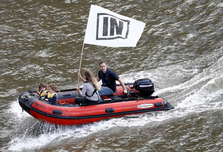 Cox's husband, Brendan Cox, and their two daughters ride an inflatable dinghy as they take part in a counter-demonstration to