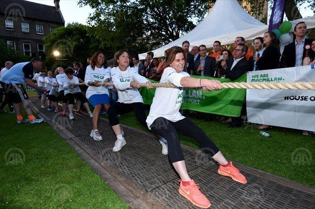 "Cox was the lead women's puller in the annual charity fundraising ""Tug of War"" competition between Britain's lower"