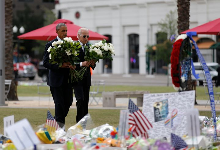 President Barack Obama and Vice President Joe Biden place flowers at a makeshift memorial for shooting victims of the massacr