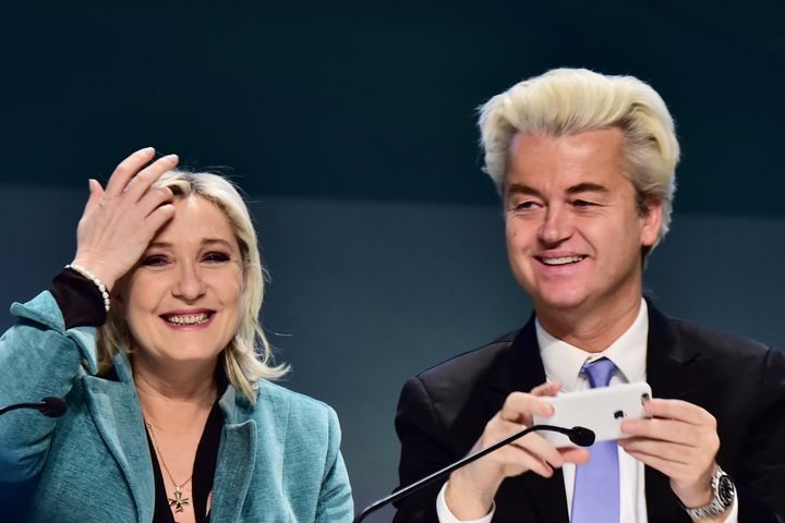 Geert Wilders (R) takes a selfie with Marine Le Pen during a press conference at the end of a gathering of European far-right