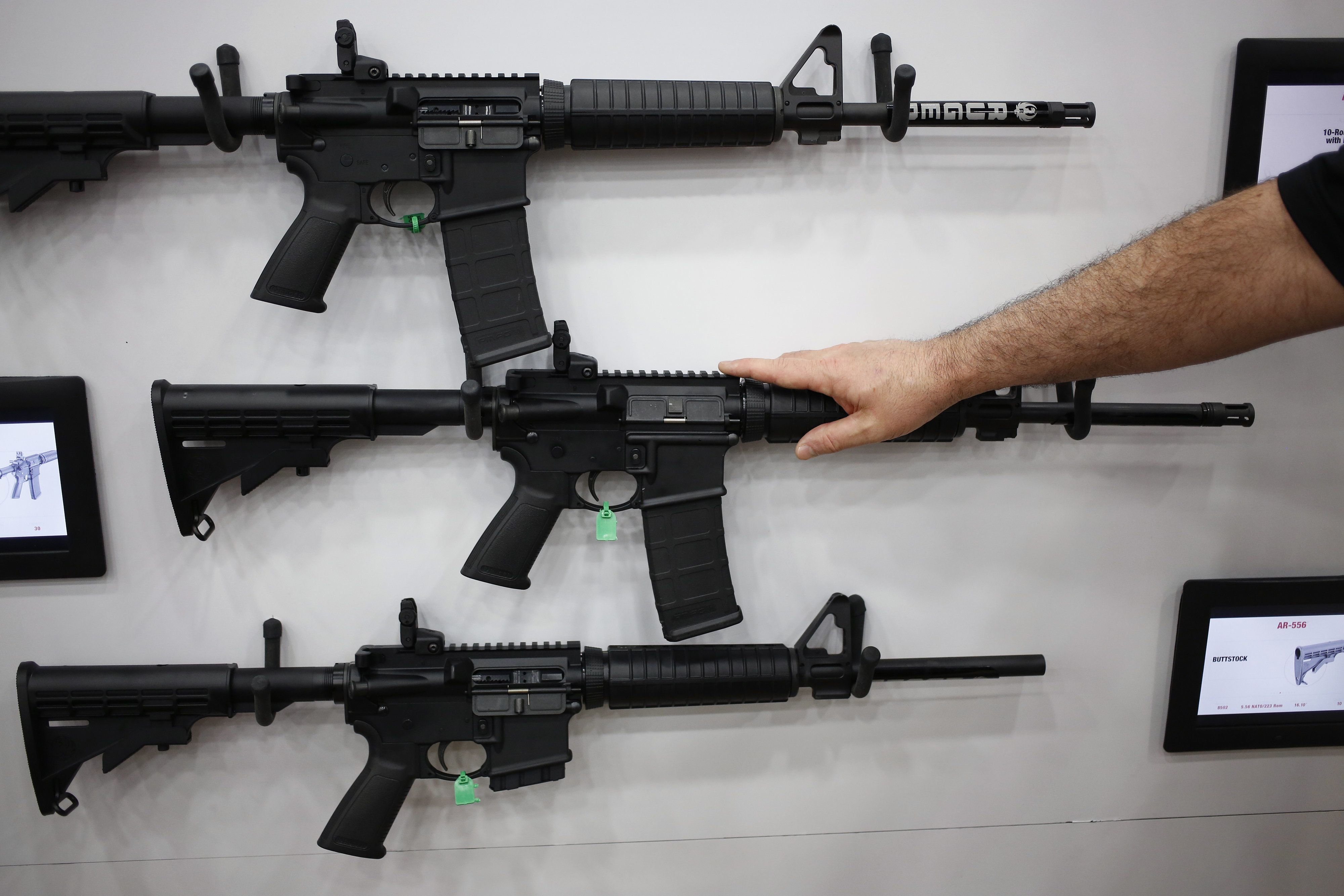 AR-15 rifles are displayed on the exhibit floor during the National Rifle Association annual meeting in Louisville, Kentucky,