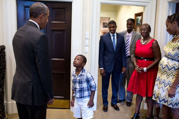 "Sept. 4, 2015  ""Four-year-old Malik Hall greets the President, almost in disbelief, before a departure photo with Malik's unc"