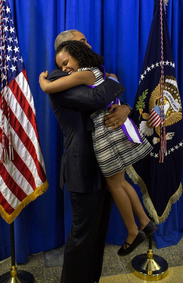 President Barack Obama hugs Mari Copeny, 8, backstage at Northwestern High School in Flint, Mich., May 4, 2016. Mari wrote a