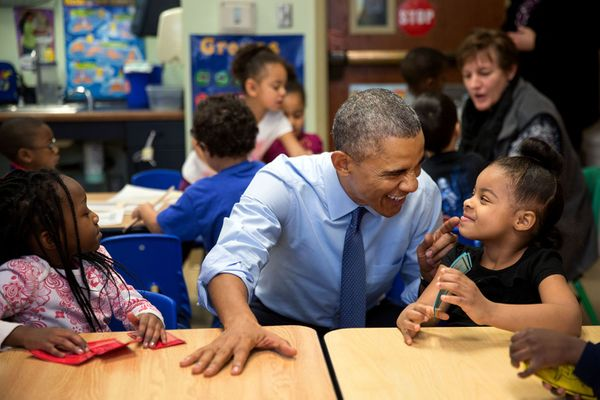 President Barack Obama gestures as he talks with Akira Cooper at the Community Children's Center, one of the nation's oldest