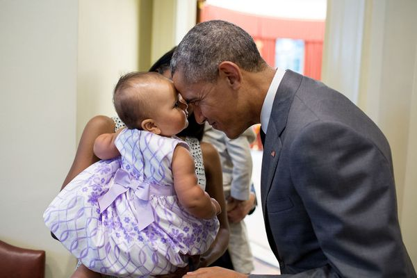 "July 17, 2015  ""The President greets nine-month-old Josephine Gronniger, whose father, Tim Gronniger, brought his family by t"