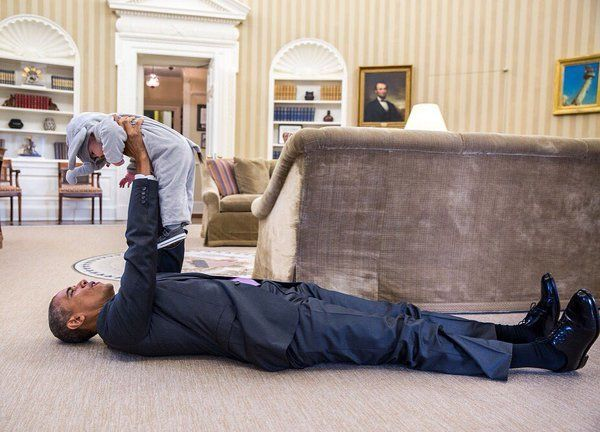 President Obama plays with Ella Rhodes in her elephant Halloween costume.  (Official White House Photo by Pete Souza)