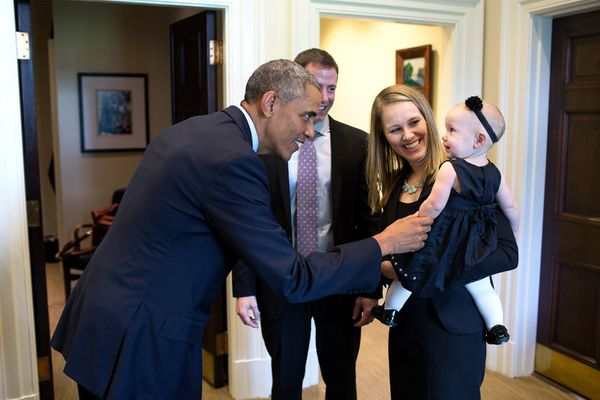 President Barack Obama greets departing staff member Lindsay Hayes and family in the Outer Oval Office, Sept. 26, 2014. (Offi
