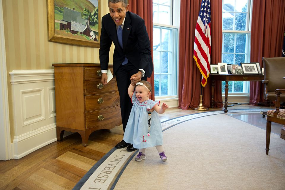 "April 4, 2014  ""Despite the haphazard framing, I love the expressions on the President and one-year-old Lincoln Rose Smith as"