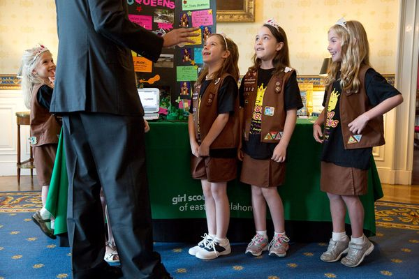 President Barack Obama talks with 8 year-old members of Girl Scout Troop 2612 from Tulsa, Okla., during the 2014 White House