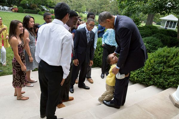 President Barack Obama greets Emmitt and Pat Smith and family, and Team 22 on the Rose Garden steps of the White House, July