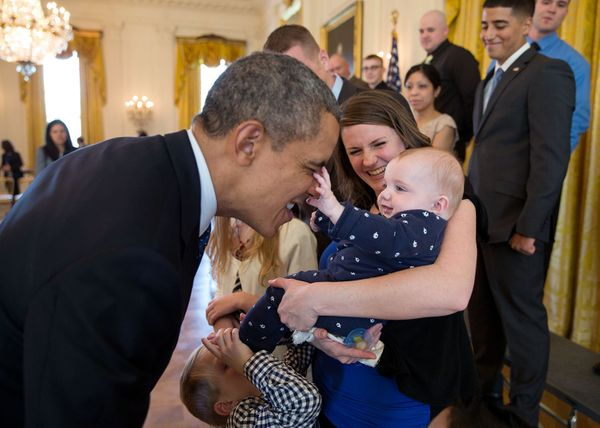 President Barack Obama plays with 5 month-old Vann Carroll during a visit with wounded warriors and their families who were t