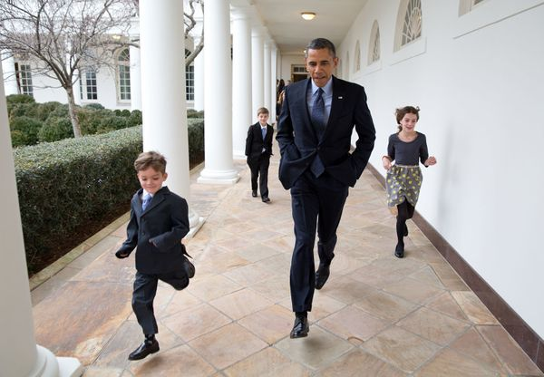 "Jan. 25, 2013  ""On a cold day, the President races down the Colonnade with Denis McDonough's children en route to the announc"