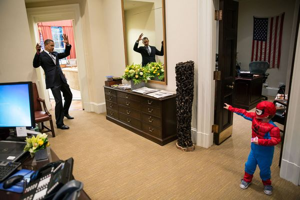"Oct. 26, 2012  ""The President pretends to be caught in Spider-Man's web as he greets Nicholas Tamarin, 3, just outside the Ov"