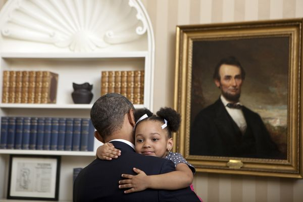 "Feb. 1, 2012  ""Lawrence Jackson captured this cute photograph of the President holding Arianna Holmes, 3, before taking a dep"