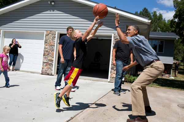 President Barack Obama plays basketball during a visit to the McIntosh family farm in Missouri Valley, Iowa, Aug. 13, 2012. T