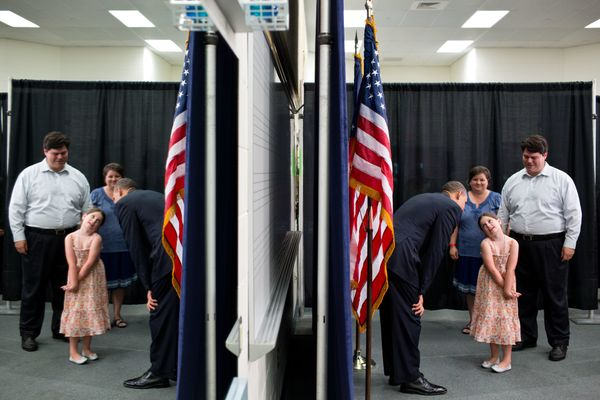 President Barack Obama greets guests before an event at Oyster River High School in Durham, N.H., June 25, 2012. (Official Wh