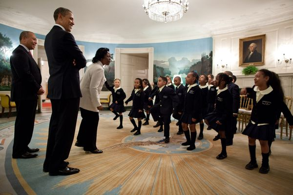President Barack Obama and Massachusetts Gov. Deval Patrick listen as students from Orchard Gardens K-8 School in Roxbury, Ma