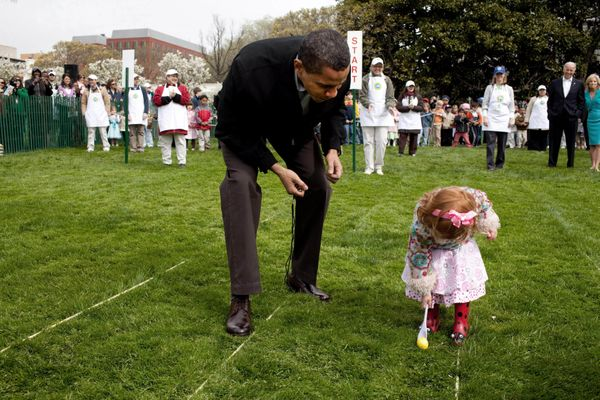 President Obama encourages a young participant at the White House Easter Egg Roll on the South Lawn April 13, 2009. (Official