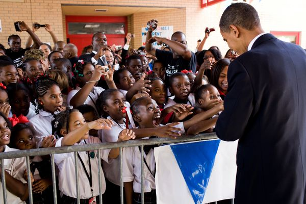 Students show their excitement at meeting President Barack Obama during his visit to Dr. Martin Luther King Jr. Charter Schoo