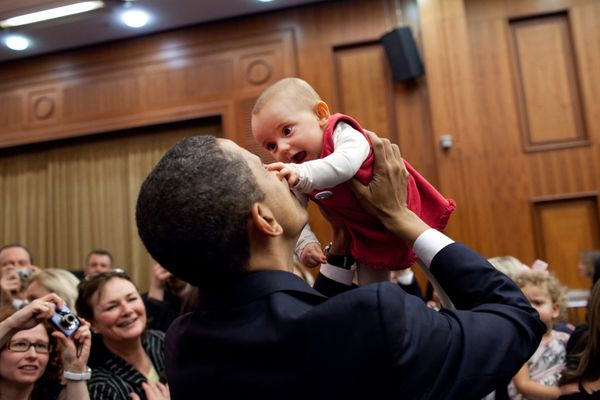 President Obama lifts up a baby April 4, 2009, during the U.S. Embassy greeting at a Prague hotel. (Official White House Phot